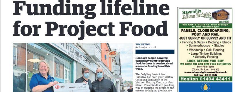 Honiton Hearing donates to local food bank